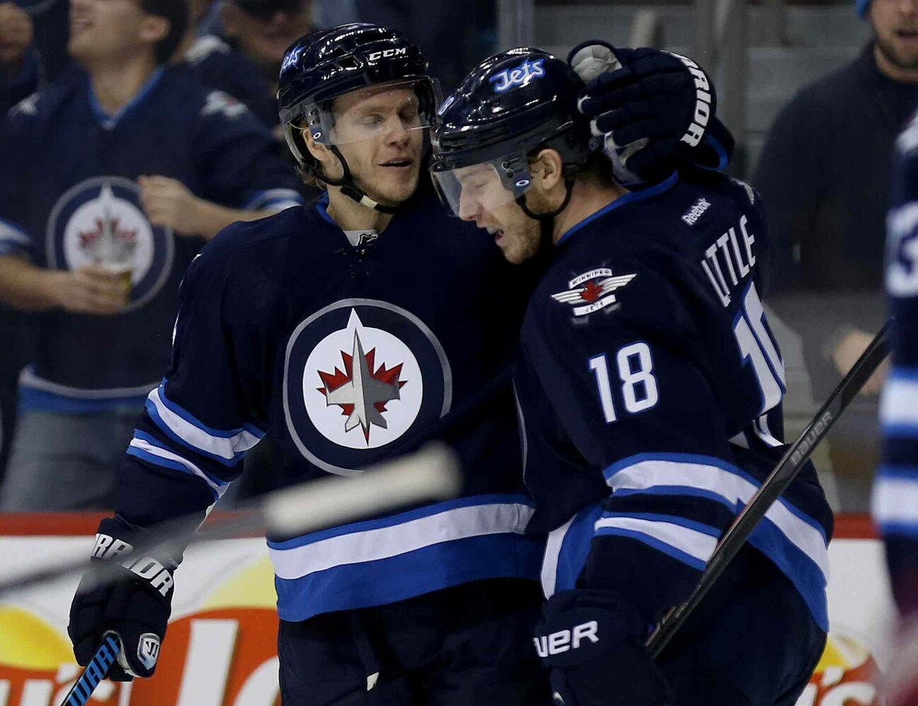 Winnipeg Jets' Tobias Enstrom (39) and Bryan Little (18) celebrate after Enstrom scored in the second period Saturday at MTS Centre. (Trevor Hagan / Winnipeg Free Press)