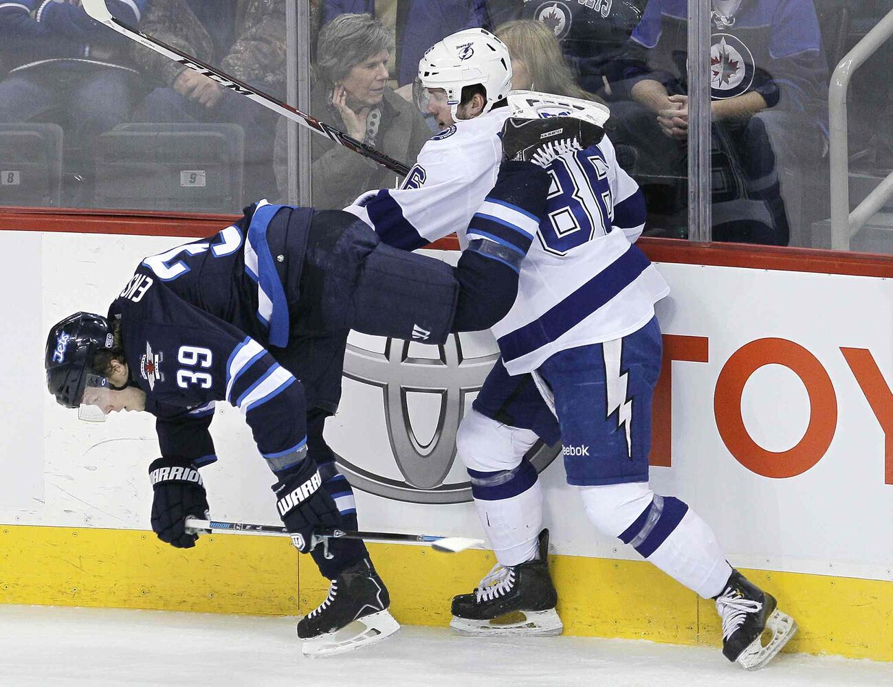 Winnipeg Jets' Tobias Enstrom (39) is checked by Tampa Bay Lightning's Nikita Kucherov (86) during the first period Tuesday. (John Woods / Winnipeg Free Press)