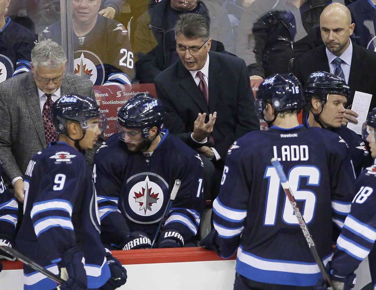 Winnipeg Jets head coach Claude Noel talks to his players during the third period.