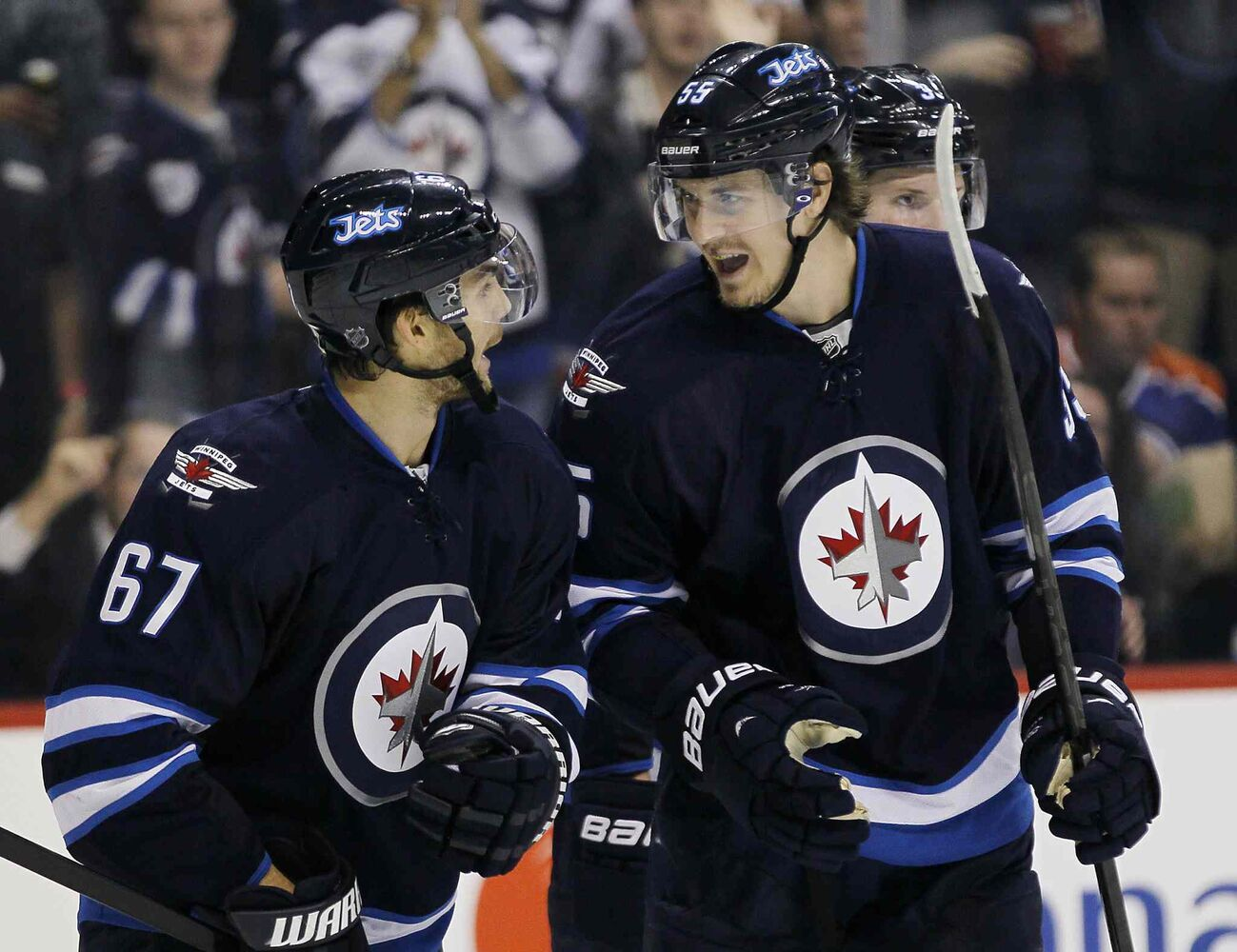 Winnipeg Jets Mark Scheifele, right, and Michael Frolik celebrate Frolik's second-period goal against the Edmonton Oilers. (JOHN WOODS / WINNIPEG FREE PRESS)