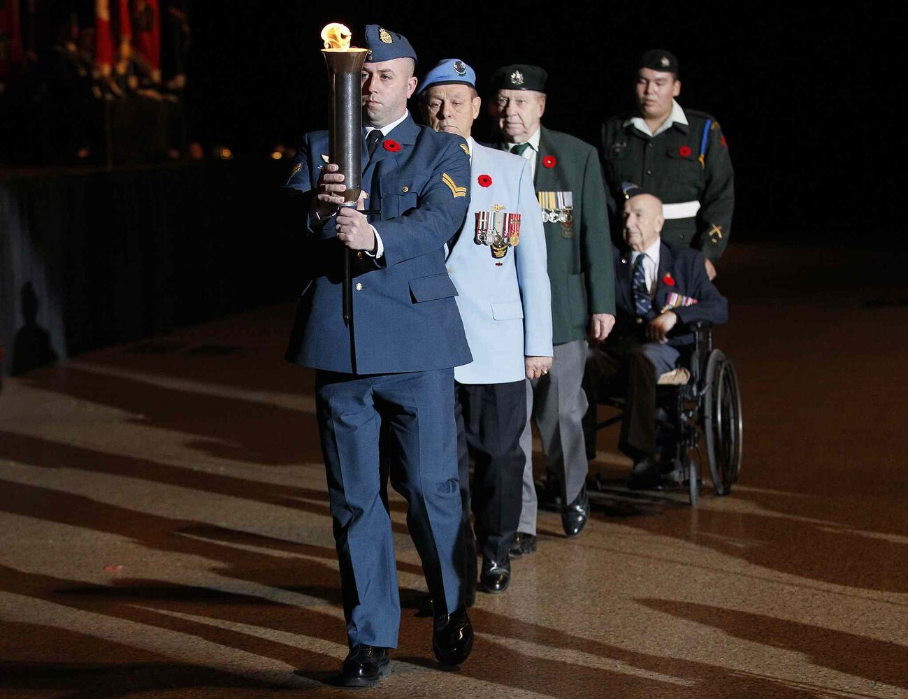 The Passing the Torch ceremony is performed during the Remembrance Day service at the RBC Convention Centre Winnipeg. (CP)