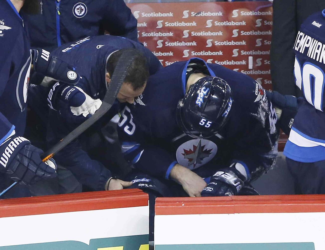 Winnipeg Jets Mark Scheifele (55) is treated on the bench after blocking a New York Rangers shot during first period. (John Woods / The Canadian Press )
