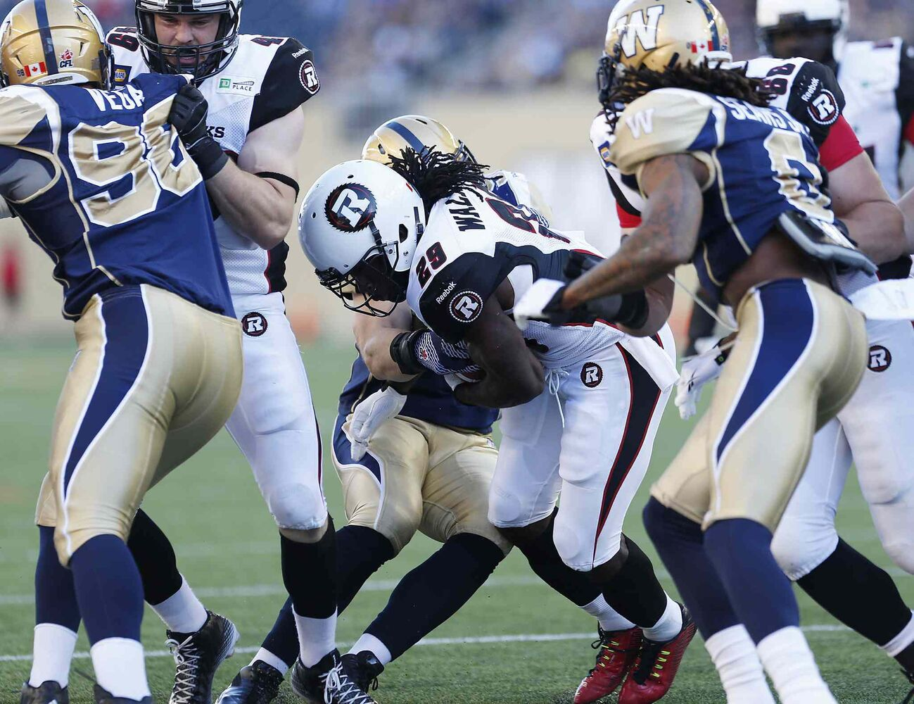 Ottawa Redblacks' Chevon Walker (29) runs the ball in for the team's first touchdown during the first half of Thursday's game against the Blue Bombers. (CP)