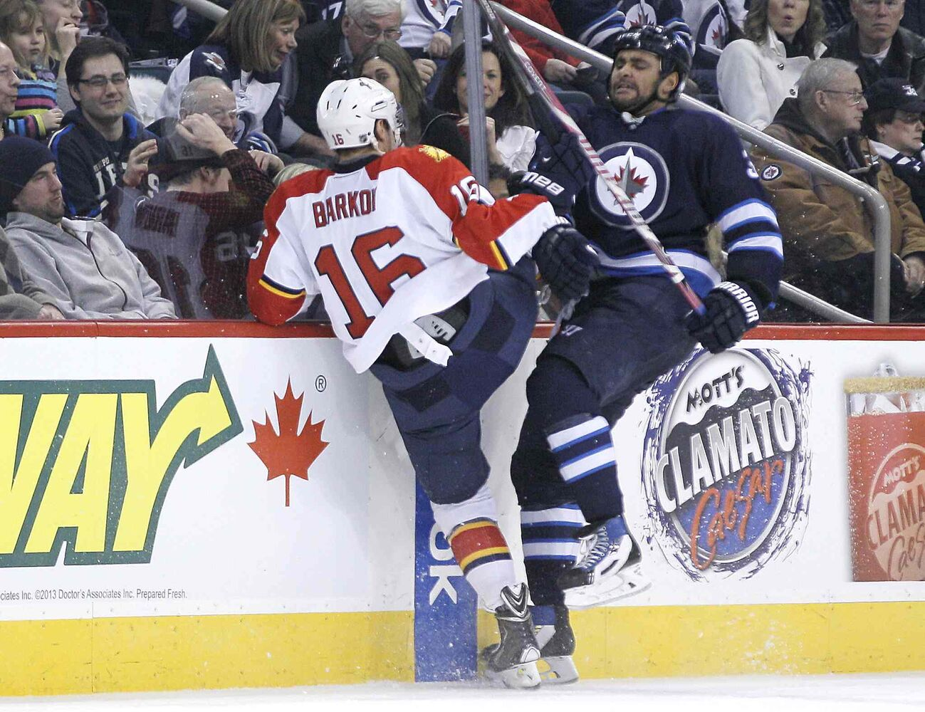 Winnipeg Jets' Dustin Byfuglien (33) and Florida Panthers' Aleksander Barkov (16) collide during the second period. (John Woods / The Canadian Press)