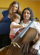 Recent Greek immigrants Stefanos Boukis, his wife, Lia Andronikou, and their daughter, Danae, left an uncertain  economic future in Greece for Winnipeg, where they have  purchased a home and started a music school.