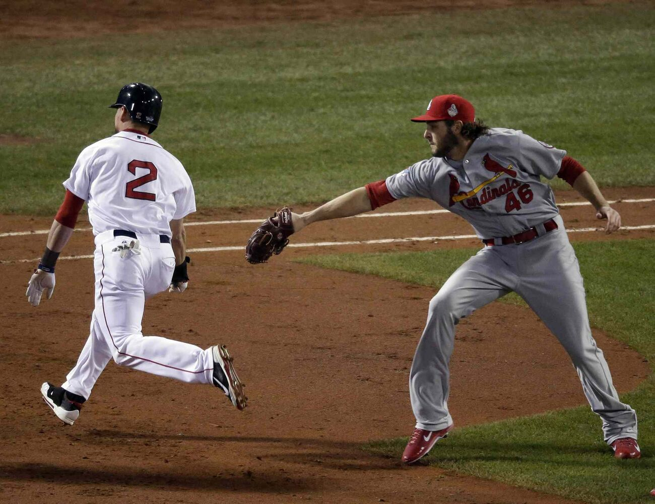 Boston Red Sox's Jacoby Ellsbury gets past St. Louis Cardinals relief pitcher Kevin Siegrist as he makes it safely back to first base on a rundown during the fifth inning. (Charlie Riedel / The Associated Press)