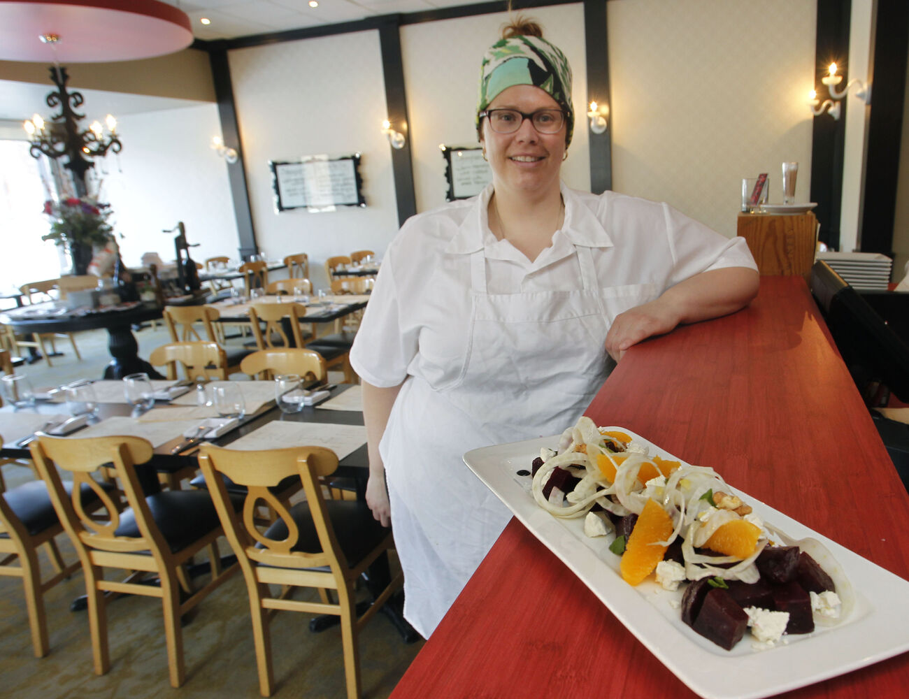 Co-owner Heather Neskar with the agro dolce beet salad. (Wayne Glowacki / Winnipeg Free Press)