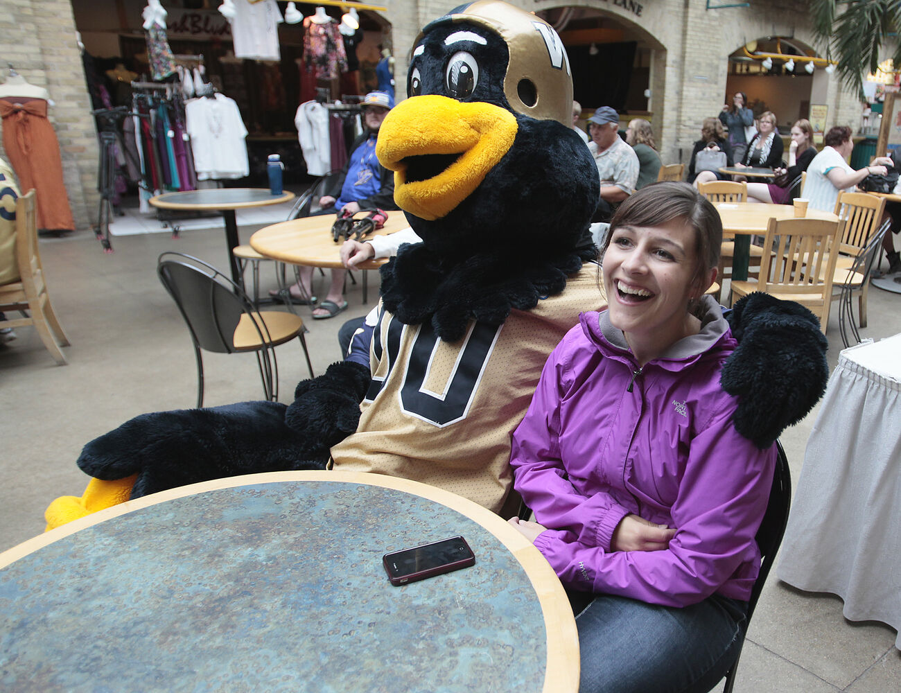 Boomer gets cozy with Sandy Broesky. (John Woods / Winnipeg Free Press)