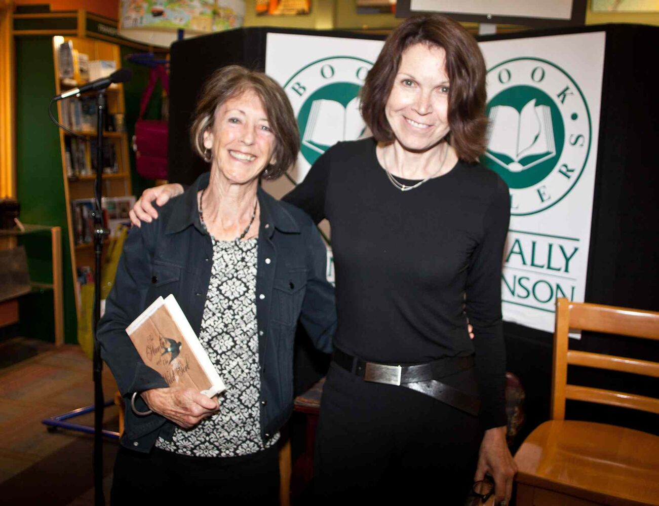 It was a two-for-one night for book signings at McNally Robinson Booksellers on Sept. 8, 2015. Pictured, from left, are authors Pauline Holdstock and Margaret Sweatman with Holdstock's The Hunter and the Wild Girl.  (JOHN JOHNSTON / WINNIPEG FREE PRESS)