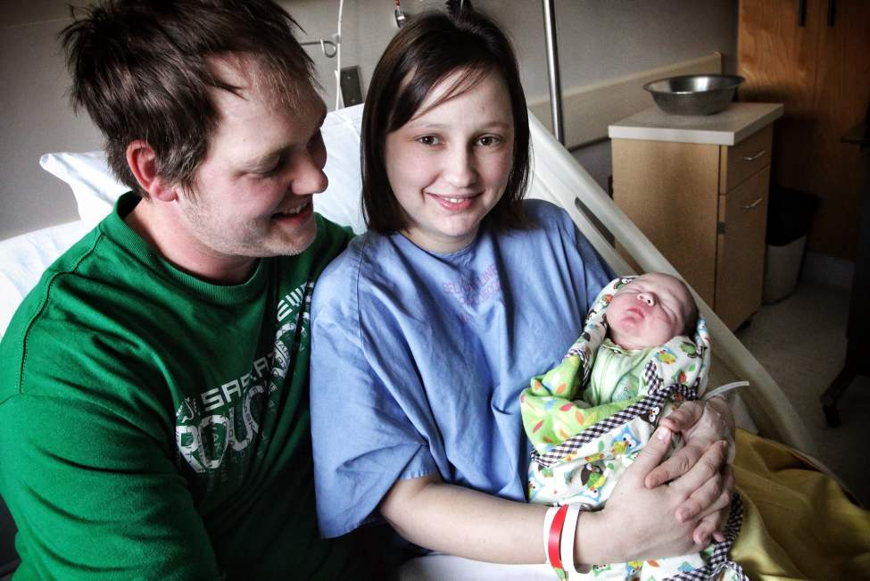 Happy parents Matthew, 30, and Desiree Girardin, 27, with New Years baby, Hudson, born at 12:40 AM weighing 7 Lbs 15 oz at St. Boniface General Hospital. January 01, 2013 (Mike Deal / Winnipeg Free Press) (Mike Deal / Winnipeg Free Press)
