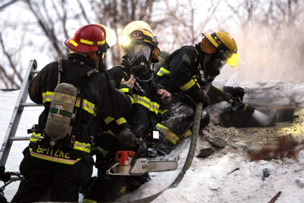 Fire crews battle a house fire in St. Boniface early this morning. The call came in around 7 a.m. for a blaze in the 400 block of Goulet Street.  January 9, 2013  BORIS MINKEVICH / WINNIPEG FREE PRESS