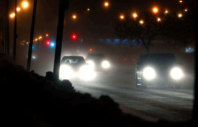 Cars on Grant Avenue near Route 90 are hampered by blowing snow this morning.
