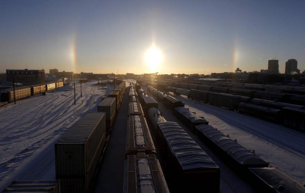 Sun dogs seen from the Slaw Rebchuk bridge overlooking the CP railyards. January 17, 2013  BORIS MINKEVICH / WINNIPEG FREE PRESS