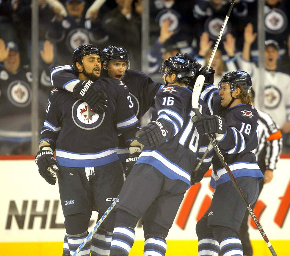 Winnipeg Jets Dustin Byfuglien is congratulated by his team mates on his first goal of the year against the Ottawa Senators at the MTS Centre in Winnipeg. January 19, 2013  BORIS MINKEVICH / WINNIPEG FREE PRESS