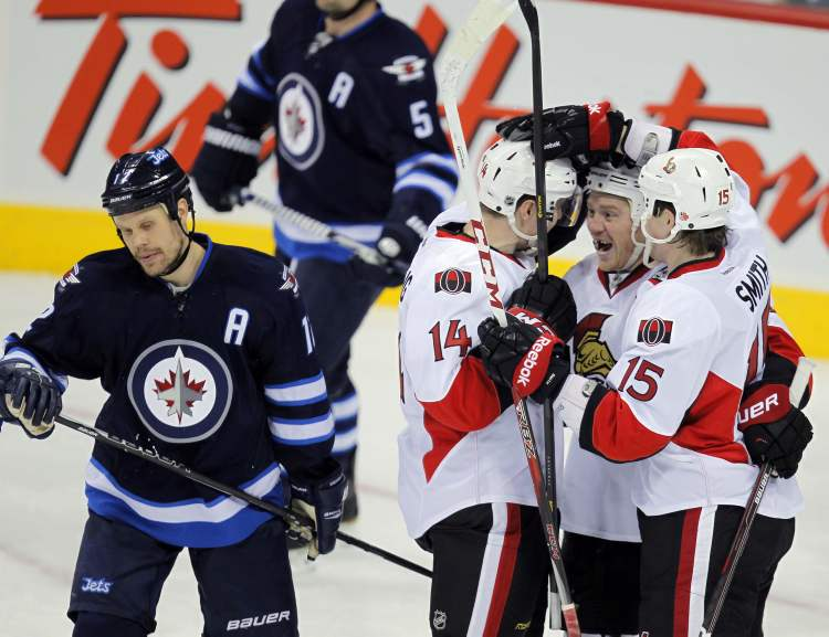 In the second period, Chris Neil scored a second goal for the Senators. Olli Olli Jokinen dejected after his shift failed to stop the goal.  (Boris Minkevich / Winnipeg Free Press)