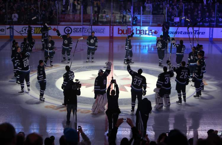The Winnipeg Jets salute the crowd prior to the first game of the season at MTS Centre, Saturday, January 19, 2013.  (TREVOR HAGAN/WINNIPEG FREE PRESS)