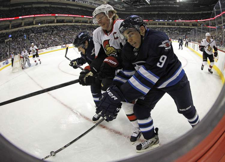 Winnipeg Jets' Kyle Wellwood and Evander Kane sandwich Ottawa Senators' Daniel Alfredsson during the second period of play at MTS Centre Saturday. (TREVOR HAGAN / WINNIPEG FREE PRESS)