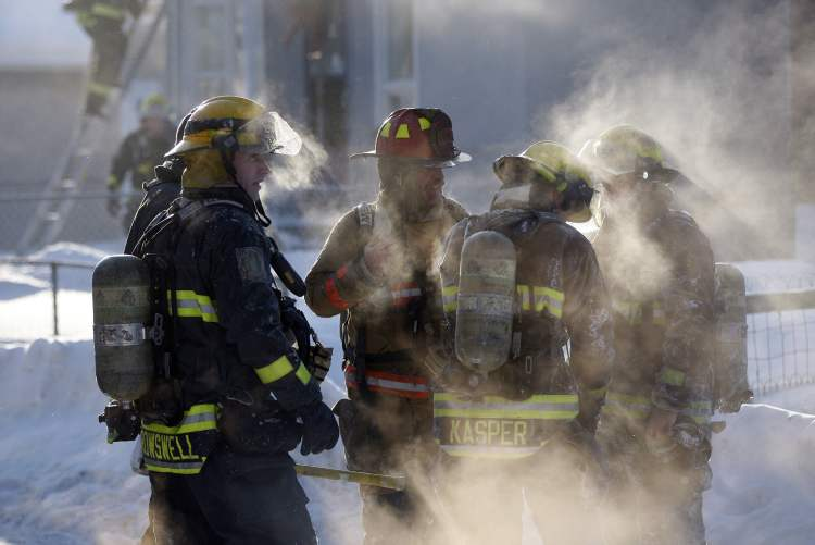Firefighters worked in very cold weather.