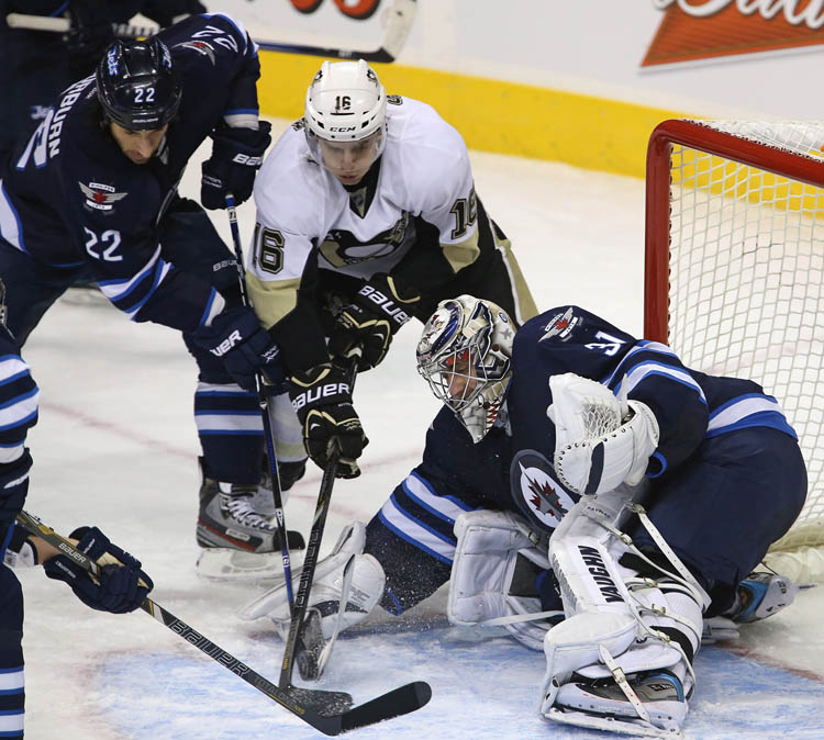 Winnipeg Jets' Chris Thorburn (22) and goaltender Ondrej Pavelec (31) stop Pittsburgh Penguins' Brandon Sutter (16) late in the third period of play at MTS Centre, Friday, January 25, 2013.