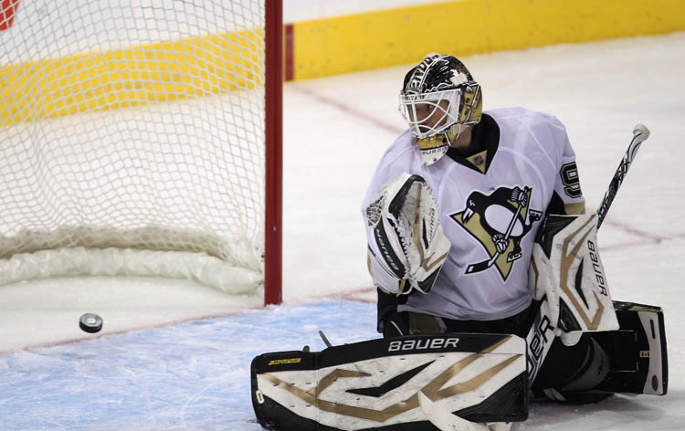 Penguins goaltender Tomas Vokoun looks back at Dustin Byfuglien's second period game-tying goal.