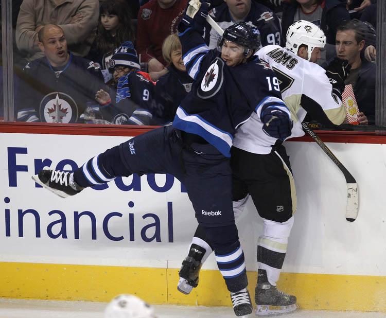 Penguins' Craig Adams and Jets' Jim Slater collide in the third period at MTS Centre Friday night. (Joe Bryksa / Winnipeg Free Press)