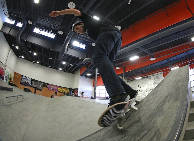 Jared Arnason, 21, a skateboarder, warms up prior to playing a game of S-K-A-T-E at The Edge Skatepark. The game is similar to playing horse.