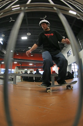 A skateboarder practices in the warmth of the city's only indoor skate park.
