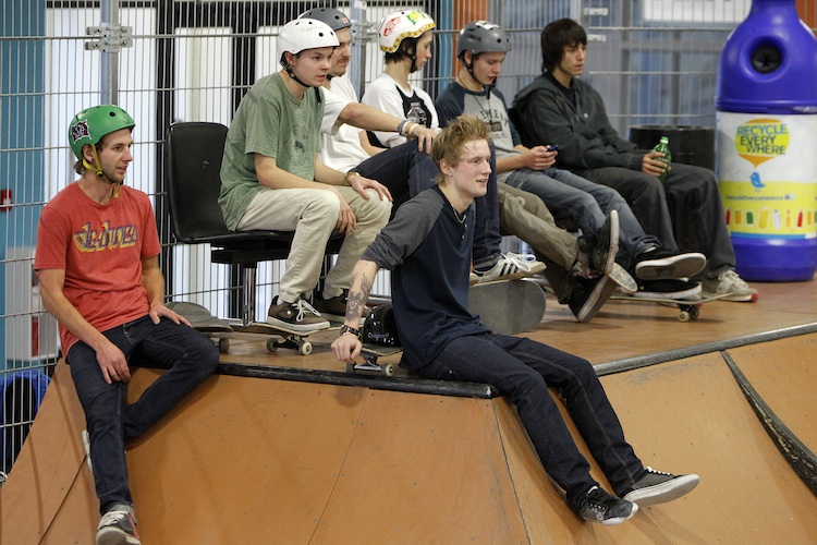 Skateboarders watching a game of S-K-A-T-E at The Edge Skatepark.