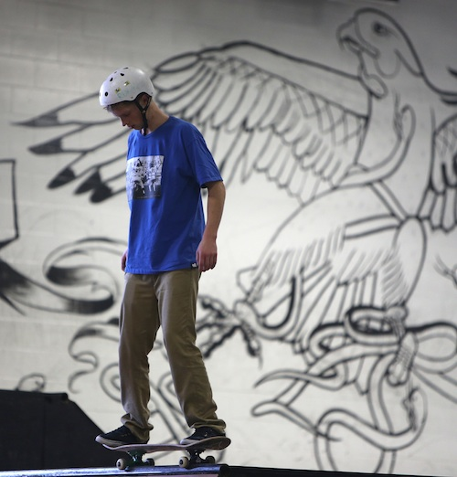A skateboarder stands in front of one of The Edge Skatepark's many murals. (TREVOR HAGAN / WINNIPEG FREE PRESS)