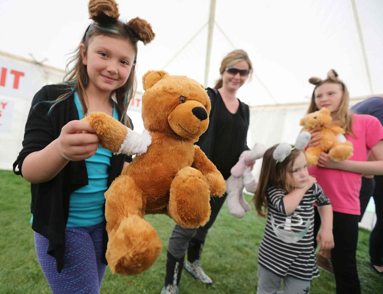 Nine-year-old Cadence Belbas shows of her bear Caramel's cast at the 28th annual Teddy Bears Picnic at Assiniboine Park Sunday. The event is a fundraiser for the Children's Hospital Foundation of Manitoba.  (Jason Halstead / Winnipeg Free Press)