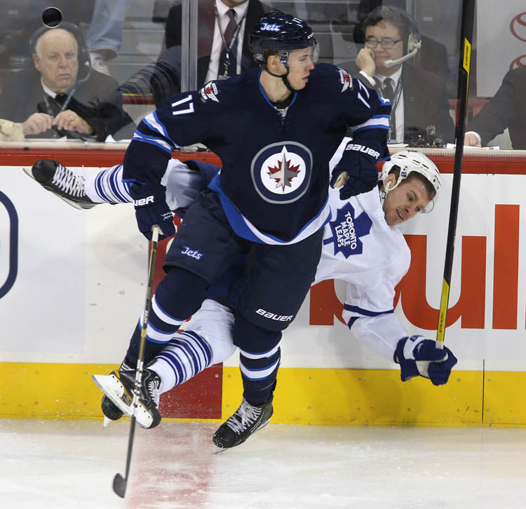 Winnipeg Jets' James Wright hits Toronto Maple Leafs' Cody Franson during the first period at MTS Centre in Winnipeg on Thursday. (Trevor Hagan / Winnipeg Free Press)