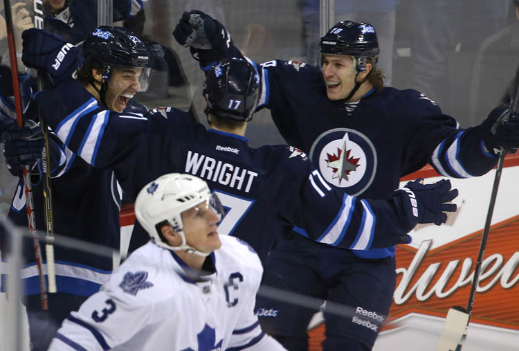 Winnipeg Jets' Zach Redmond (left) is congratulated by teammates James Wright (17) and Bryan Little (18)  after Redmond scored his first NHL goal, short handed in the second period against the Toronto Maple Leafs at MTS Centre in Winnipeg Thursday. (TREVOR HAGAN / WINNIPEG FREE PRESS)