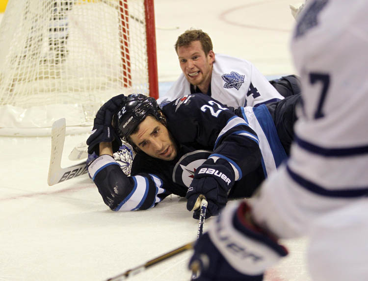 Toronto Maple Leafs Goalie James Reimer looses his helmet after Winnipeg Jets' Chris Thorburn crashed into the net during the 3rd period  Thursday night at MTS Centre. (Ruth Bonneville / Winnipeg Free Press)