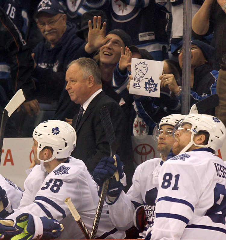 Toronto Maple Leafs coach Randy Carlyle gets a standing ovation Thursday night at MTS Centre with some mixed feelings from Jets fans, after he was welcomed back to Winnipeg, where he spent 18 years as a player and coach. (Ruth Bonneville / Winnipeg Free Press)