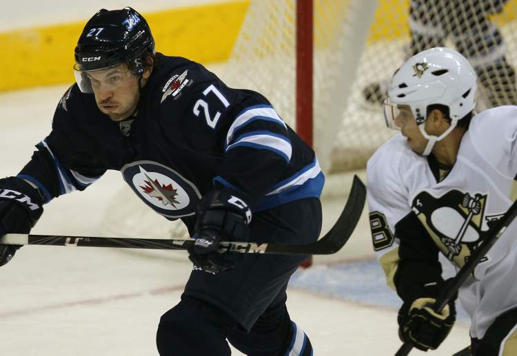 Pittsburgh Penguins Tyler Kennedy gives chase to new Winnipeg Jets Eric Tangradi in front of the net during second period NHL action  Friday night in Winnipeg. (JOE BRYKSA / WINNIPEG FREE PRESS)