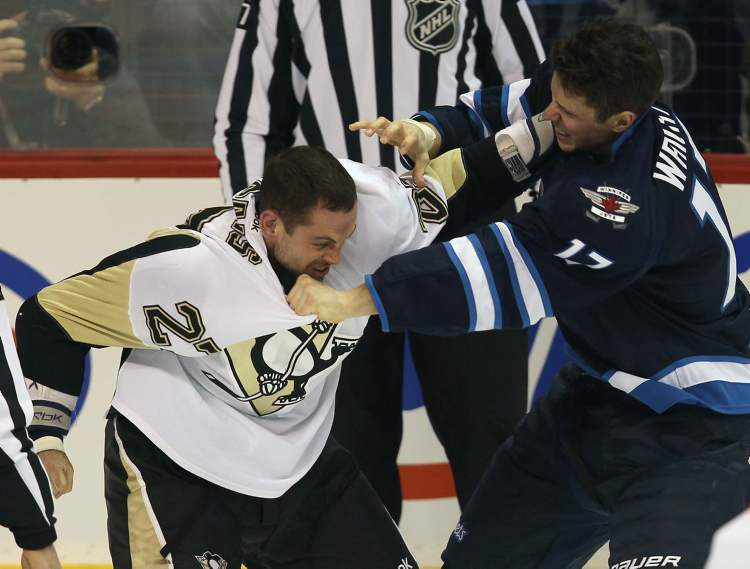 Pittsburgh Penguins Craig Adams and Winnipeg Jets James Wright get in a fight during second period NHL action in Winnipeg.   