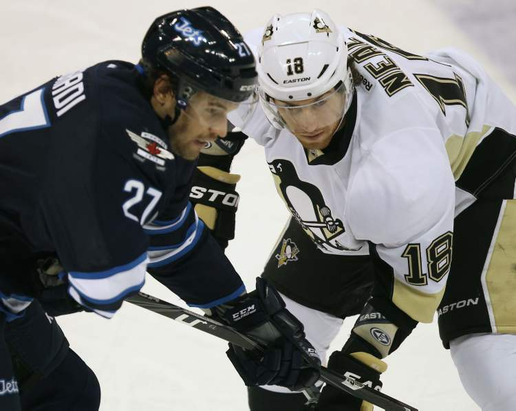 Winnipeg Jets Eric Tangradi, left, lines up with Pittsburgh Penguins James Neal during first period action. The Jets lost the game 3-1. (JOE BRYKSA / WINNIPEG FREE PRESS)