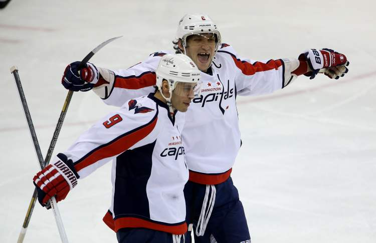 Washington Capitals' Mike Ribeiro, left, and Alexander Ovechkin celebrate after the pair combined for a Ribeiro goal during the third period of Saturday's game. (TREVOR HAGAN / WINNIPEG FREE PRESS)
