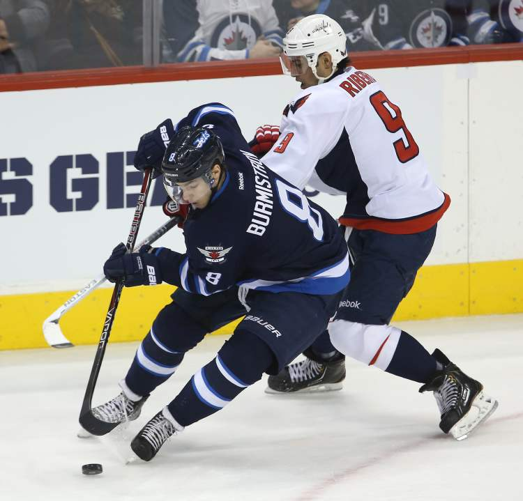 Winnipeg Jets forward Alexander Burmistrov tries to lose Washington Capitals forward Mike Ribeiro during third-period action in Saturday afternoon's game. (TREVOR HAGAN / WINNIPEG FREE PRESS)