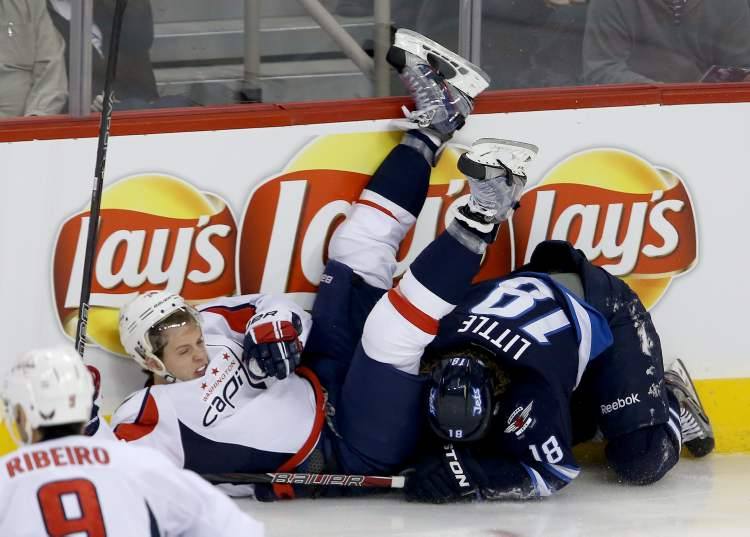 Washington Capitals defenseman John Carlson ends up on top of Winnipeg Jets forward Bryan Little after they got tangled up in the first period of Saturday afternoon's game at the MTS Centre. (TREVOR HAGAN / WINNIPEG FREE PRESS)