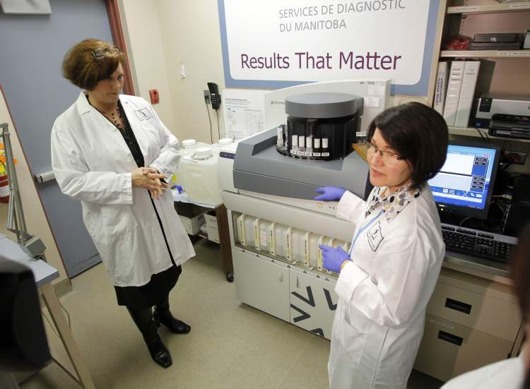 Health  Minister Theresa Oswald (left) with Micheline Philippot-Rosset next to the new diagnostic  machine at St.  Boniface General Hospital Tuesday.