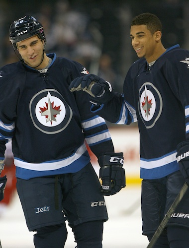 Evander Kane, right, has a laugh with Winnipeg Jets teammate Patrice Cormier in the pre-game skate.  (JOE BRYKSA / WINNIPEG FREE PRESS)