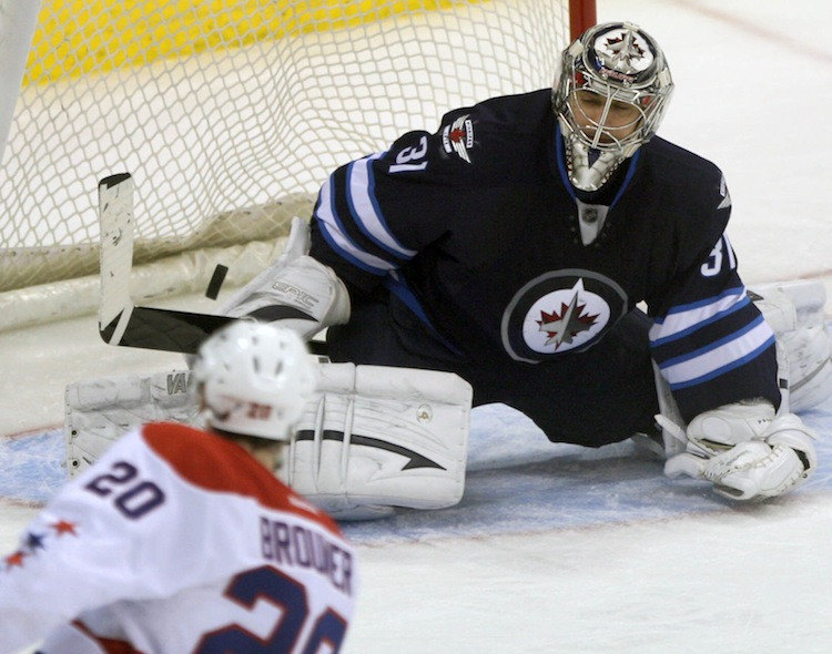 Winnipeg Jets goalie Ondrej Pavelec is beaten by Troy Brouwer of the Washington Capitals during the first period of Friday night's game at the MTS Centre.