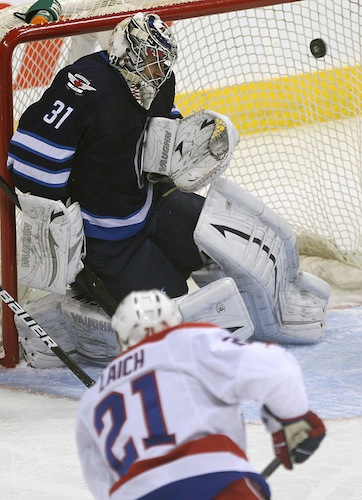 Winnipeg Jets goalie Ondrej Pavelec is beaten by Washington Capitals' Brooks Laich during the first period of Friday night's game at the MTS Centre. (JOE BRYKSA / WINNIPEG FREE PRESS)