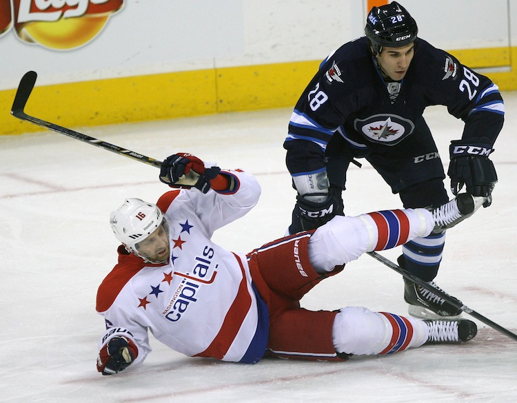 Patrice Cormier of the Winnipeg Jets is tied up with Washington Capitals (and ex-Jets) forward Eric Fehr during first-period action in Friday night's game. (JOE BRYKSA / WINNIPEG FREE PRESS)
