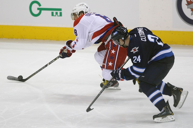Winnipeg Jets defenceman Grant Clitsome chases Alexander Ovechkin of the Washington Capitals in the third period of Friday night's game.