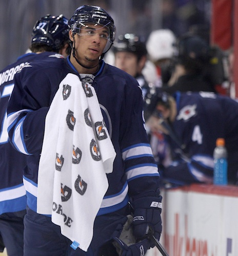 Evander Kane skates by the Jets bench during a stoppage in play in the second period of Friday night's game against the Washington Capitals. (JOE BRYKSA / WINNIPEG FREE PRESS)