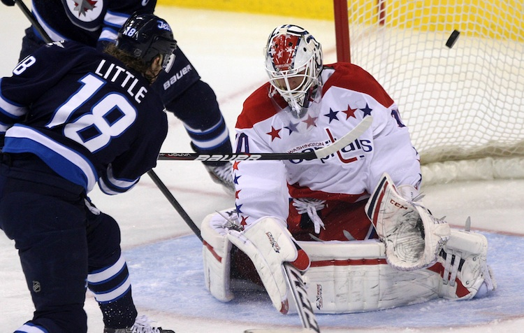 Bryan Little misses an open net over the shoulder of Washington Capitals goalie Braden Holtby during the third period of Friday's game. (JOE BRYKSA / WINNIPEG FREE PRESS)