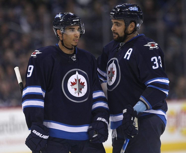 Winnipeg Jets Evander Kane, left, and Dustin Byfuglien chat during a break in second-period action against the Washington Capitals Friday night. (JOE BRYKSA / WINNIPEG FREE PRESS)