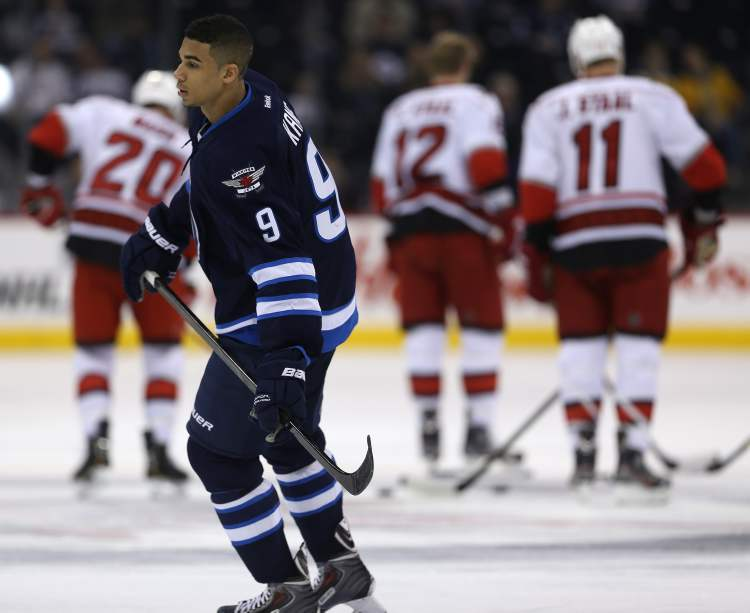 Winnipeg Jets' Evander Kane (9) looks for the puck during warmup as the Jets' prepare to face the Carolina Hurricanes at MTS Centre in Winnipeg, Saturday.